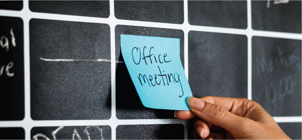 "Post-it note with ""Office meeting"" written on it"