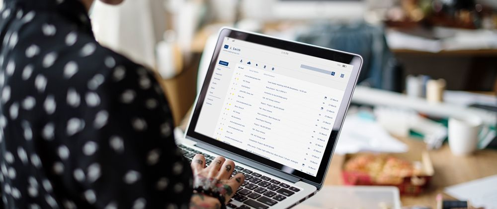 Person looking at email inbox on laptop